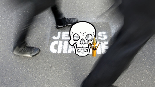 "People walk past a grafitti tag reading ""I am Charlie"" as they take part in a solidarity march (Marche Republicaine) in the streets of Paris"
