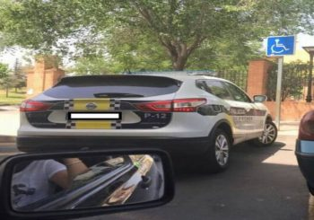 Woman fined for posting Facebook pic of police car parked at disabled spot