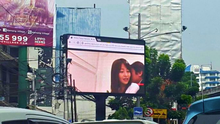 Someone hacked this billboard in Indonesia and defaced with Japanese porn