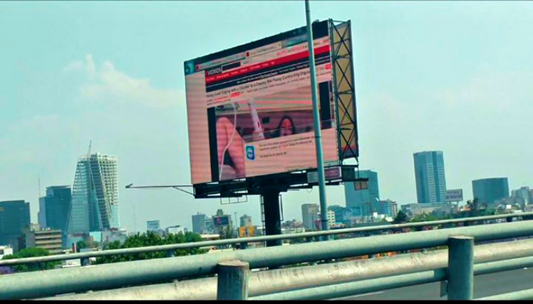 Someone hacked this billboard in Mexico and defaced with porn video
