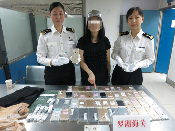 Woman arrested for smuggling 102 iPhones, 15 Watches to China